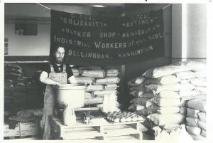 Preparing food for a Food For People dinner at the old Fairhaven Cooperative Flour Mill. Note the IWW banner. 1982