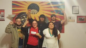 Fellow Worker Anja with her paycheck and Twin Cities IWW supporters. photo from TCOrganizer.com
